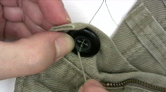 Sewing A Button Stock Footage