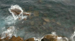 Rocks crash sea ocean water waves coast Stock Footage