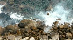 rocks crash sea ocean water waves coast - stock footage
