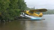 Seaplane in the rain – wide shot. Stock Footage