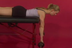 Fit woman doing back exercises with a barbell - stock footage