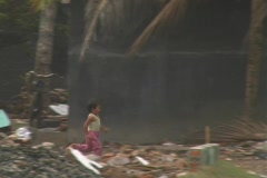 Girl runs through tsunami destruction - stock footage