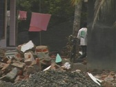 Girl runs through tsunami destruction Stock Footage