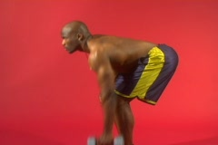 Muscular black man doing back exercises with a dumbbell Stock Footage