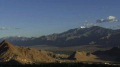 Mountain valley to monastery pan Stock Footage