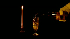 Waiter serving white wine in candle light Stock Footage