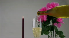 Serving white wine with roses and candle Stock Footage