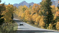 Autumn forest mountain car on road M HD Stock Footage