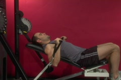 Fit man doing a chest exercise on a cable machine - stock footage