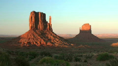 Sunset on the Mittens at Monument Valley Navajo Tribal Park in AZ - time lapse  Stock Footage