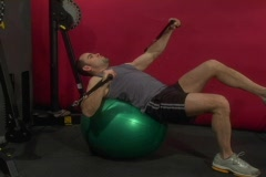 Fit man doing a chest exercise on a stability ball Stock Footage