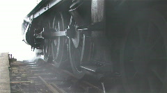 Steam train wheels & smoke Stock Footage