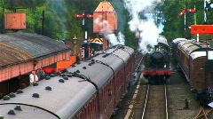Steam train leaving the station Stock Footage