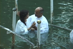 Baptism of pilgrims in the Jordan River Holy Land Israel - stock footage