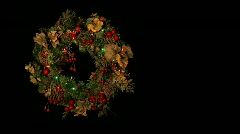 Christmas wreath with blinking colored lights Stock Footage