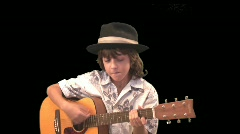A young guitarist wearing his hat Stock Footage
