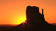 Monument Valley, dramatic orange sunrise in Arizona, time lapse  Stock Footage