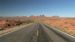 Road Leading to Monument Valley Navajo Tribal Park in Arizona Stock Footage