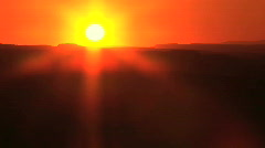 Orange Sunset Behind Silhouette of Mountains, American Southwest, Time Lapse Stock Footage