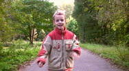 Running child in autumnal park Stock Footage