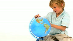 Little boy with globe Stock Footage