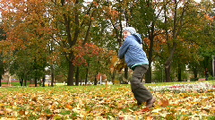 Child throw autumn leaves Stock Footage