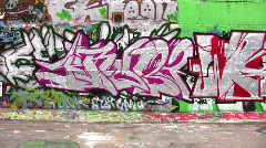 Bicycle car and graffiti wall Stock Footage