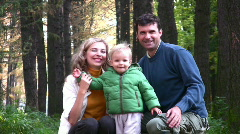 Parents with boy in park Stock Footage