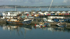 Fishing boats and fish market at Brixham Devon England. Stock Footage