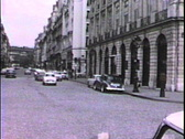 Paris street with cars-From 1950's film Stock Footage