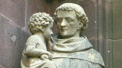 Statue on a gothic church in france Stock Footage