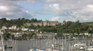 Stock Video Footage of Boats moored on the river Dart zoom into the Royal Naval College Dartmouth