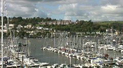 Boats moored on the river Dart below the Royal Naval College Dartmouth. Stock Footage