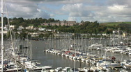 Stock Video Footage of Boats moored on the river Dart below the Royal Naval College Dartmouth.