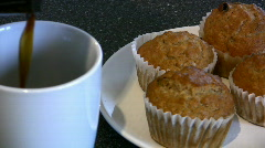 Pouring Coffee With A Plate Of Muffins - stock footage