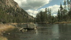 River at bottom of mountain Stock Footage