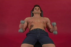 Fit man doing an inclined chest exercise - stock footage