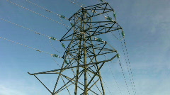 Tilt up to overhead electricity supply power line pylon or tower. Stock Footage