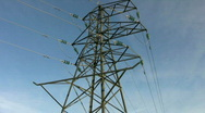 Stock Video Footage of Tilt up to overhead electricity supply power line pylon or tower.