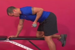 Fit man doing triceps exercise with a dumbbell - stock footage