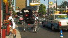 A rickshaw (jinrikisha) in Asakusa in Tokyo, Japan Stock Footage