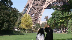 Two People looking at Eiffel Tower Stock Footage