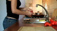 Man and woman preparing food - time lapse  Stock Footage