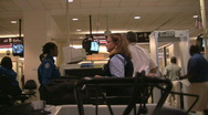 Going through airport security Stock Footage
