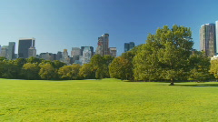 Beautiful morning in park pan shot Stock Footage