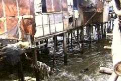 Shanties in Floating Garbage Stock Footage
