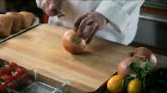 Chef chops onion Stock Footage