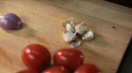 Chef expertly chops shallot Stock Footage