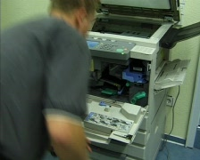 Maintenance of a copier by technical staff - stock footage