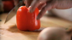 Chef cutting orange pepper into julienne Stock Footage